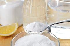 Natural cleaners. Vinegar, baking soda, salt and lemon. Stock Photos