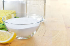 Natural cleaners. Vinegar, baking soda, salt and lemon. Stock Photos
