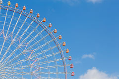 Natural clear blue sky with big ferris Wheel. In amusement park Stock Photos