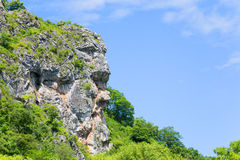 Natural cliff in the shape of a human head Royalty Free Stock Image