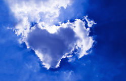 Natural cloud heart. In the blue sky background Royalty Free Stock Photo