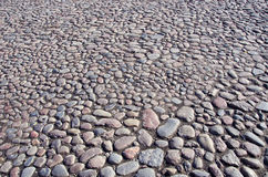Natural cobblestone sidewalk in city square Stock Photo
