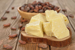 Natural cocoa butter. On a brown background Stock Images
