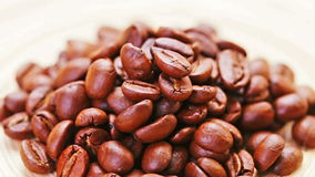 Natural coffee beans heap rotating stock video