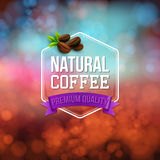 Natural coffee poster. Typography design on a soft bokeh backgro Stock Images