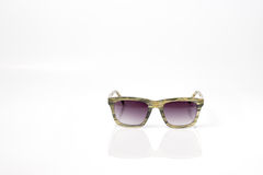 Natural color fashion sun glasses with purple lens Stock Photos
