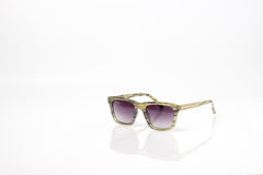 Natural color fashion sun glasses with purple lens Royalty Free Stock Image
