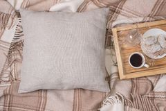 Natural color linen pillow, cushion Mockup on plaid. Inrerior photo Royalty Free Stock Photography