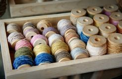 Natural colorful dye of cotton thread on wood roll : Closeup. Natural colorful dye of cotton thread on wood roll : Close up Royalty Free Stock Images