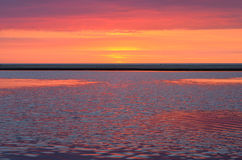 Natural colorful sunset. Natural colorful sunset over the river Irbe flowing into the Baltic Sea Stock Photos