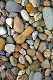 Sea pebbles background. Stones seamless pattern. seamless background with smooth pebble. royalty free stock photo