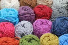 Natural coloured wool. In balls royalty free stock photo