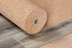 Natural cork Substrate for a laminate. Natural cork substrate in a roll on the floor with a laminate Royalty Free Stock Photography