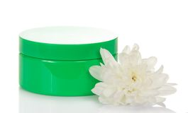Natural cosmetic green cream jar and flower Royalty Free Stock Image