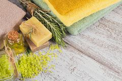 Natural cosmetic oil and natural handmade soap with rosemary on Royalty Free Stock Image