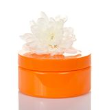 Natural cosmetic orange cream jar Royalty Free Stock Photography