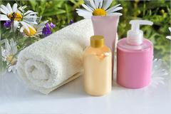 Natural Cosmetic products for skin care and terry cotton towel Royalty Free Stock Photos