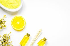 Natural cosmetic seasalt and oil on white background top view mo. Natural cosmetic seasalt for homemade spa and organic aroma oil on white background top view Stock Image