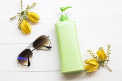 Natural cosmetic sunscreen body lotion health care for body skin. Natural cosmetics sunscreen body lotion health care for body skin and sunglasses of lifestyle stock photos