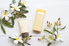 Natural cosmetic sunscreen spf50 health care for skin face. Natural cosmetics sunscreen spf50 health care for skin face with body lotion  of lifestyle woman royalty free stock photos