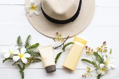 Natural cosmetic sunscreen spf50 health care for skin face. Natural cosmetics sunscreen spf50 health care for skin face with body lotion ,hat of lifestyle woman stock image