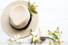 Natural cosmetic sunscreen spf50 health care for skin face. Natural cosmetics sunscreen spf50 health care for skin face with hat of lifestyle woman relax summer stock photos