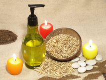 Natural cosmetic and three candle. Stock Photo