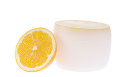 Natural cosmetic for your skin. Container for cream and slice of juicy orange isolated on white background Stock Images