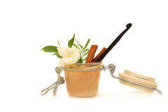 Natural cosmetics. A jar with some white creamy substance and flowers, plant and spice Royalty Free Stock Photography