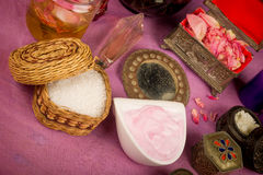 Natural cosmetics. Assortment of natural cosmetics with some of their ingredients royalty free stock image
