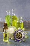 Natural cosmetics collection - cream, essential and aromatic oil of passion flower. Natural cosmetics collection - cream, serum, essential and aromatic oil of stock images