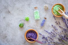 Natural cosmetics with lavender and herbs for homemade spa on stone background top view mock up. Natural cosmetics with lavender and herbs for homemade spa on stock photography