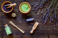 Natural cosmetics with lavender and herbs for homemade spa on wooden background top view Royalty Free Stock Photography