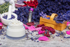 Natural cosmetics, lavender and rose petals. Natural cosmetics, cream of lavender and rose petals stock photography