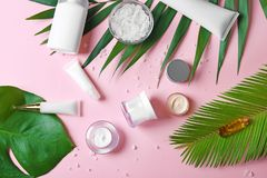 Natural cosmetics and leaves. On pink background stock photography