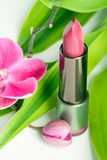 Natural cosmetics: lipstick with bamboo and orchid Stock Photo