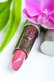 Natural cosmetics: lipstick with bamboo and orchid Royalty Free Stock Image
