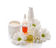 Natural cosmetics products with pearls and flowers Royalty Free Stock Image