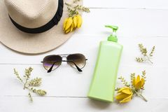 Natural cosmetic sunscreen body lotion health care for body skin. Natural cosmetics sunscreen body lotion health care for body skin and sunglasses of lifestyle stock photography