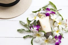 Natural cosmetic sunscreen spf50 health care for skin face. Natural cosmetics sunscreen spf50 health care for skin face with hat of lifestyle woman relax summer royalty free stock photo