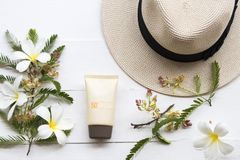 Natural cosmetic sunscreen spf50 health care for skin face. Natural cosmetics sunscreen spf50 health care for skin face with hat of lifestyle woman relax summer royalty free stock image