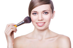 Natural cute woman with brush Royalty Free Stock Photo