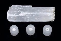 Natural decorative selenite log and selenite cylinder tea light holders Stock Images