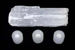 Natural decorative selenite log and selenite cylinder tea light holders Stock Photography
