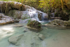 Natural deep forest tropical blue stream waterfall Royalty Free Stock Images