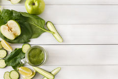 Natural detox green smoothie ingredients on white wood background Stock Photo