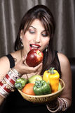 Natural diet. Beautiful indian model girl holding fruits and vegetables in basket stock images