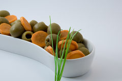 Natural diet food. olives and carrots. Fitness food. Stock Photos