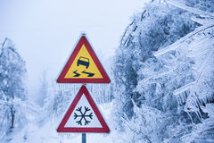 Natural disaster: dangerous and icy road with sleet covered trees Stock Image