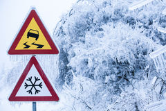 Natural disaster: dangerous and icy road with sleet covered trees. Dangerous and icy road with sleet covered trees Royalty Free Stock Photography